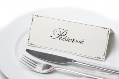 Reserved sign in french with fork and knife