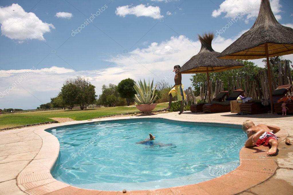 Kids playing around a swimming pool