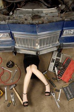 Female mechanic fixing stuff