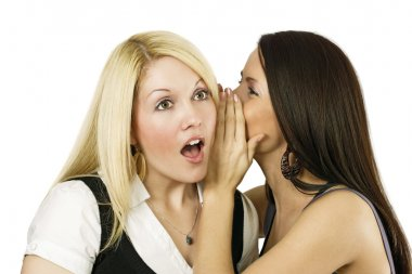 Two women whispering secrets