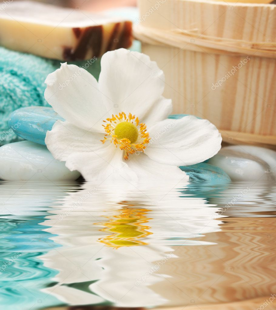 spa setting with flower and blue candle stock photo mythja 4251562. Black Bedroom Furniture Sets. Home Design Ideas