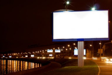 The big white billboard on night quay