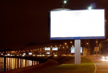 The big white bill-board on night quay