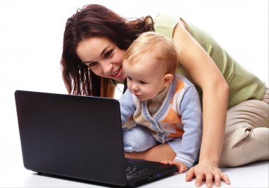 Mother an her son are playing with laptop