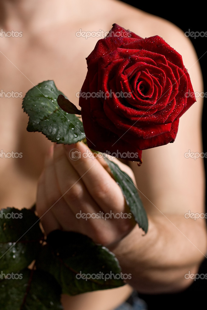 The man with a red rose in hands