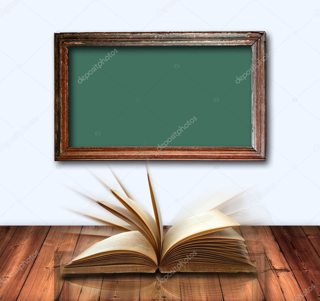 Open book on wood table