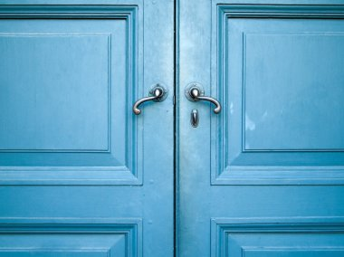 Old double door painted with blue