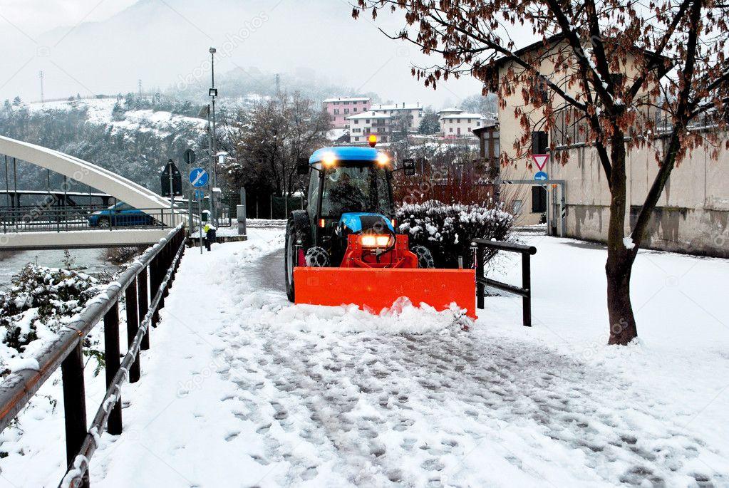Bulldozer shoveling snow