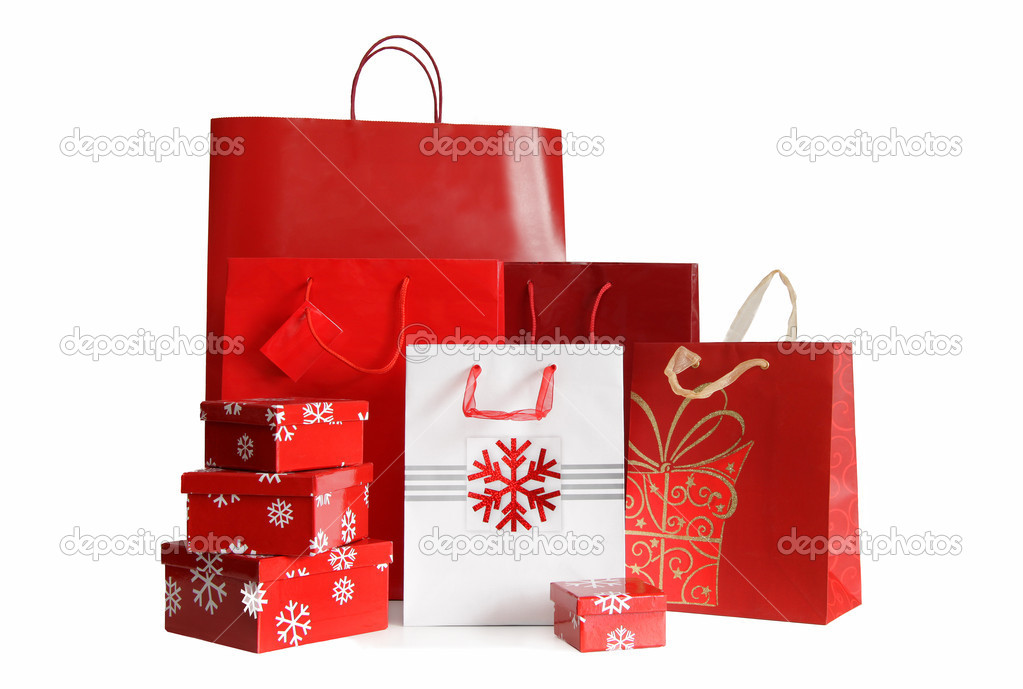 Various sizes of holiday shopping bags and gift boxes on white