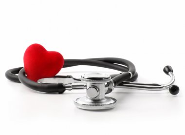 Stethoscope with heart on white background