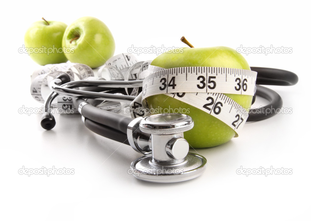 Green apples with stethoscope against white background