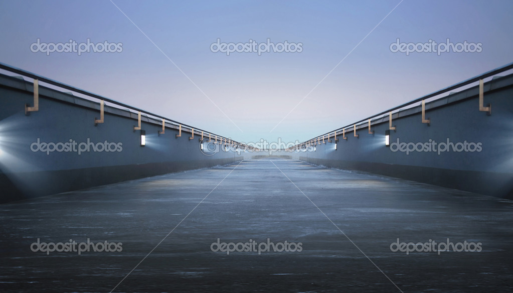 Road through the bridge with blue sky background