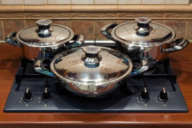Set the pan on the stove