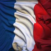 Vlajka Francie, vlající ve větru, podsvícený vycházející slunce
