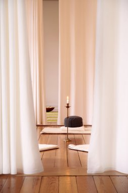 Meditation room with white curtains