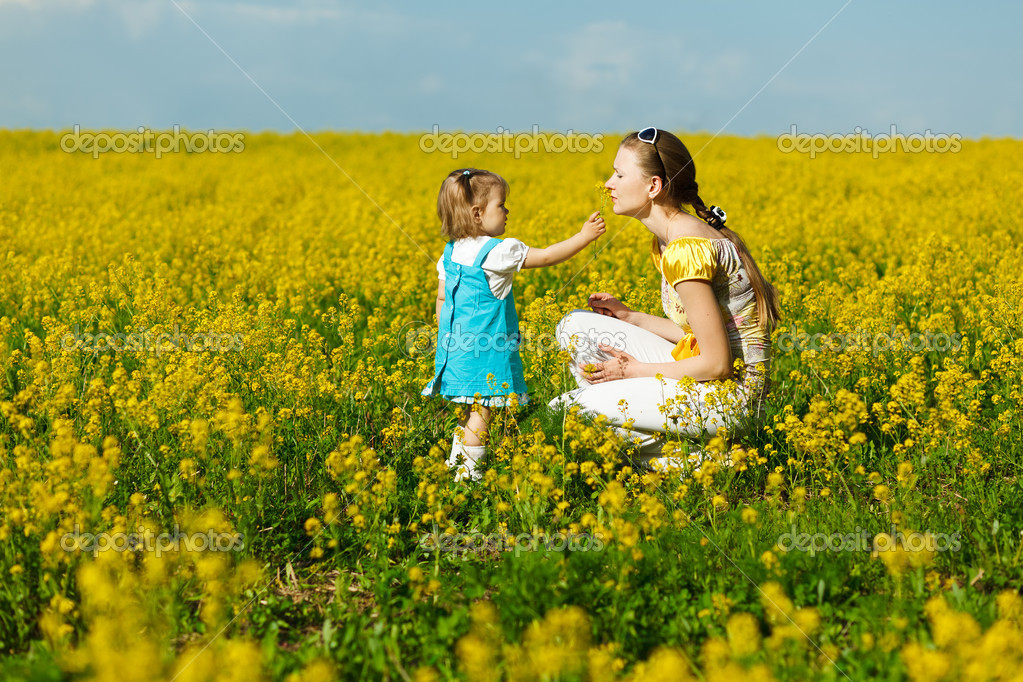 Mother with baby on field