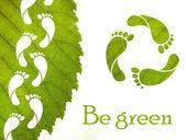 lábnyom recycle jel és a zöld leveles
