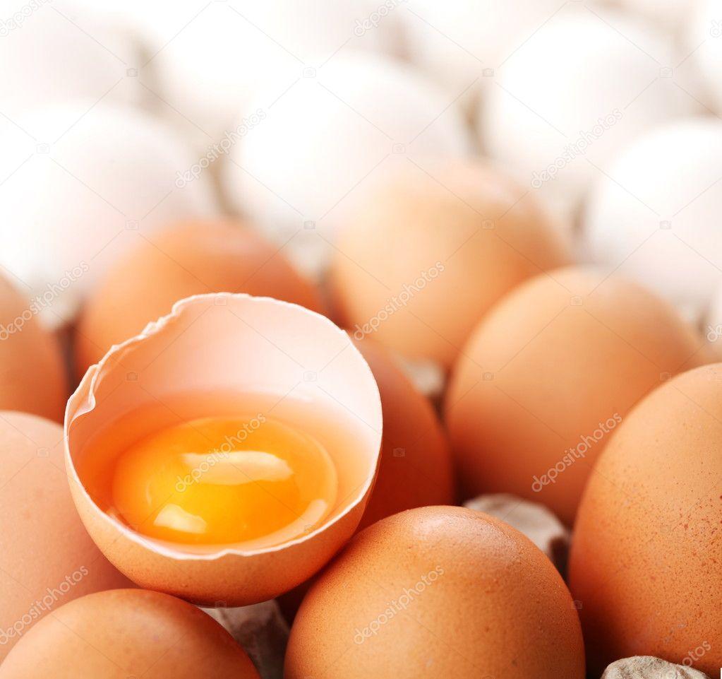 Broken brown egg is among the whites of eggs.