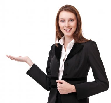 Young woman in business suit shows her empty palm. Isolated on a