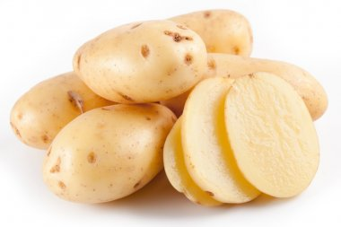Yellow potatoes with segments on a white background
