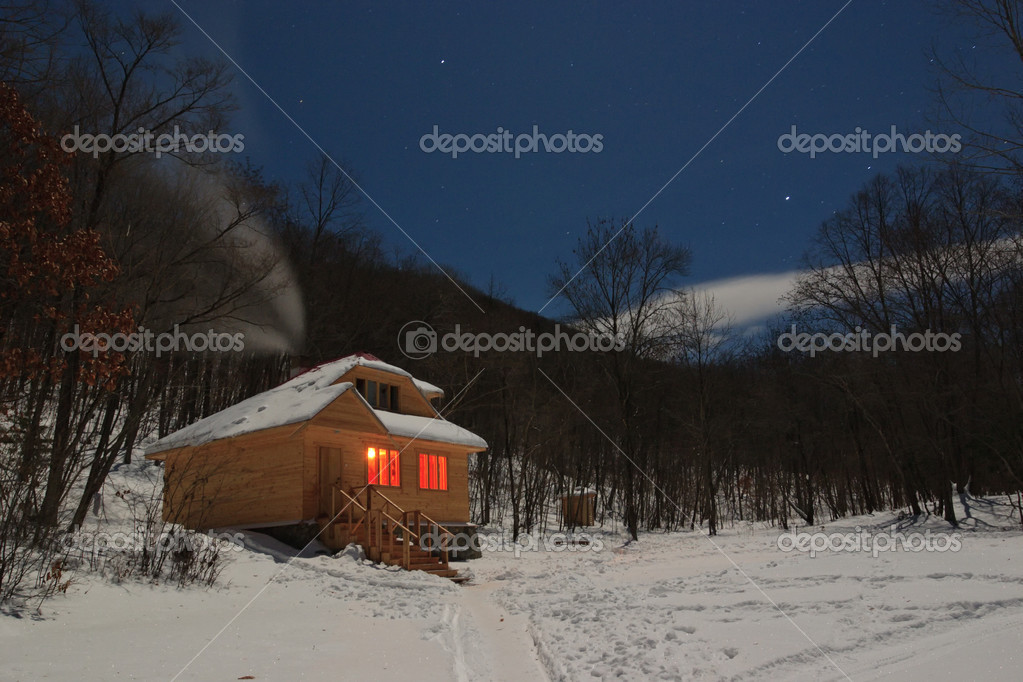 Wooden house for a holiday with illuminated windows