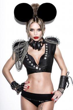 A woman dressed as a fashion cartoon mouse with big ears.