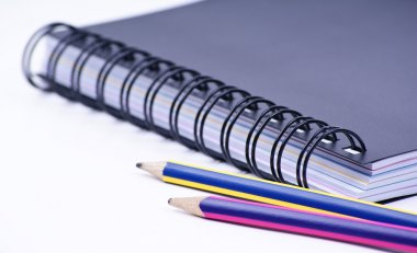 Notebook with a colored pencils