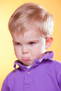Blonde little upset boy pout