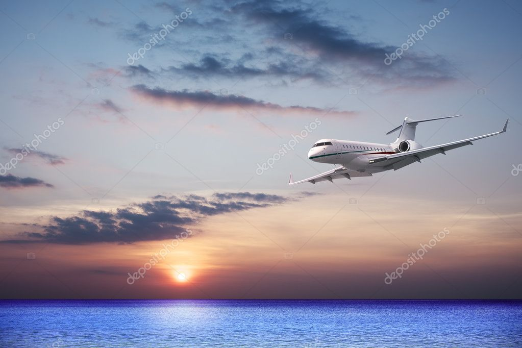 Private jet cruising at sunset
