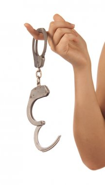 Woman hand with handcuffs