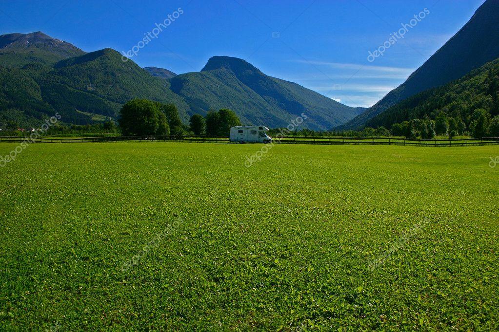 Camper and grass field