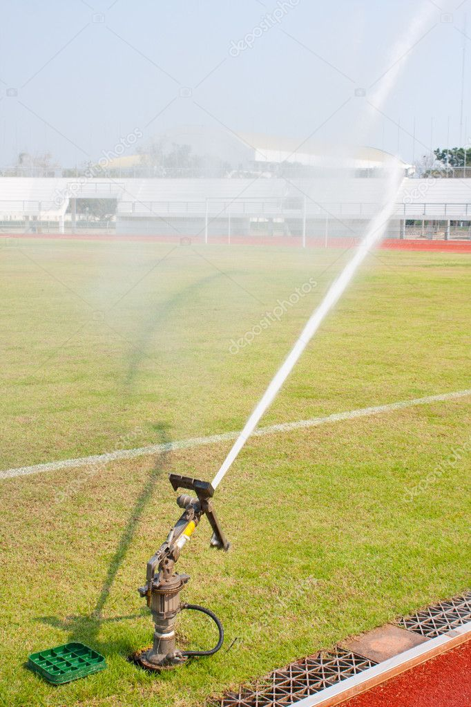 Nozzles are watering the field.