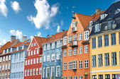 Fotografie Colorful Danish houses near famous Nyhavn canal in Copenhagen, Denmark