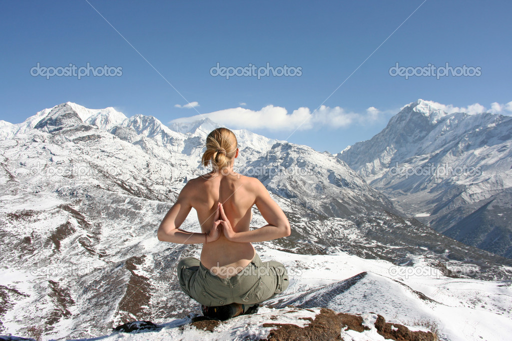 Woman meditate in mountains