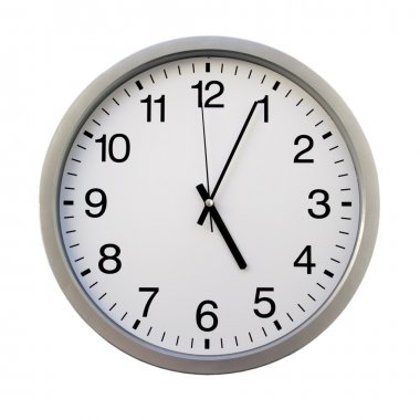 Five o'clock on the white wall clocks (isolated)