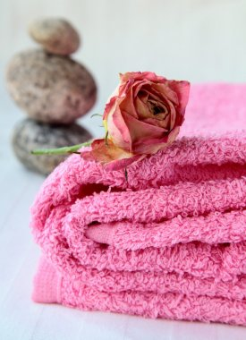 Pink towel with rose