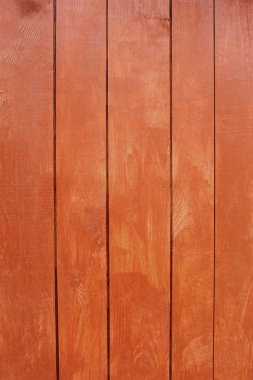Parallel wooden planks, painted in red