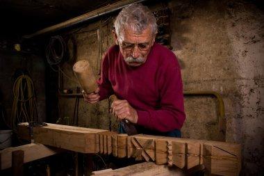 Woodcarver work in the workshop 1