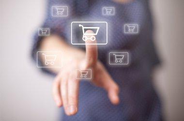 Woman hand pressing shopping cart icon stock vector