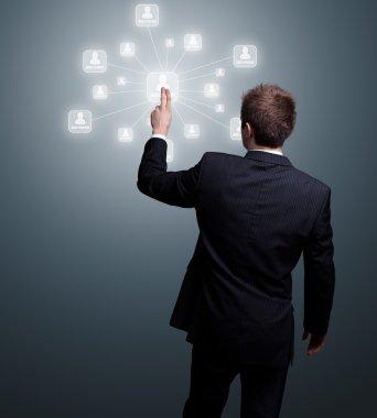 Businessman hand pressing Social network icon stock vector