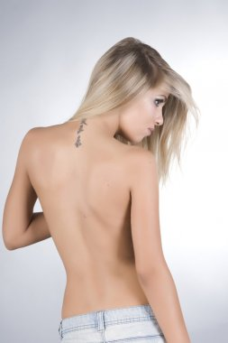 Beautiful fashion model with a tattoo on his back