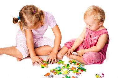 Children solving jigsaw puzzle