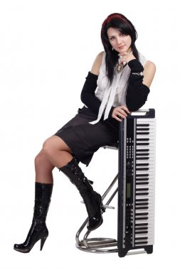 Beautiful girl sitting with synthesizer isolated