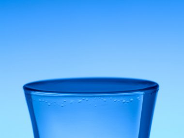 A shot of vodka on blue background. stock vector