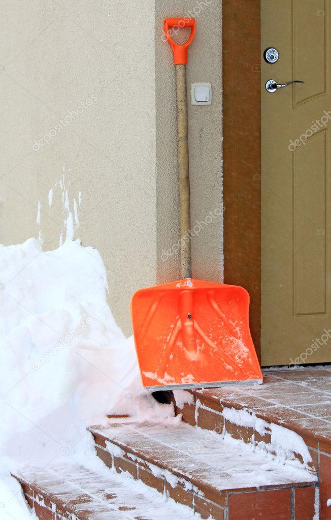 Snow shovel and front door
