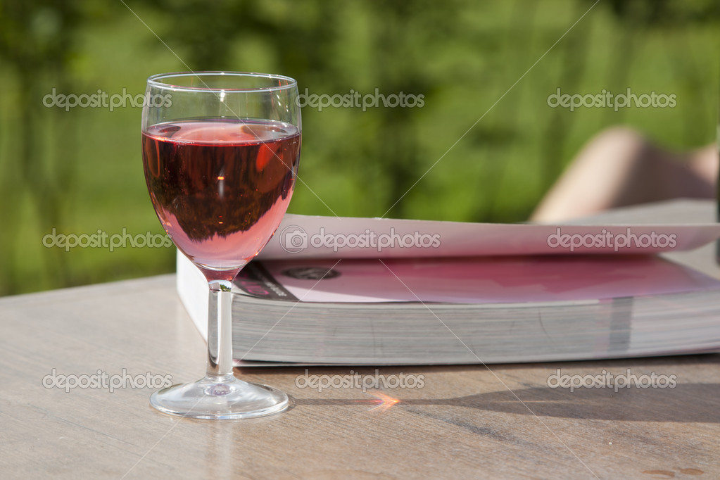 Still life of wine and book