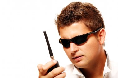 Young security man with radio transmitter