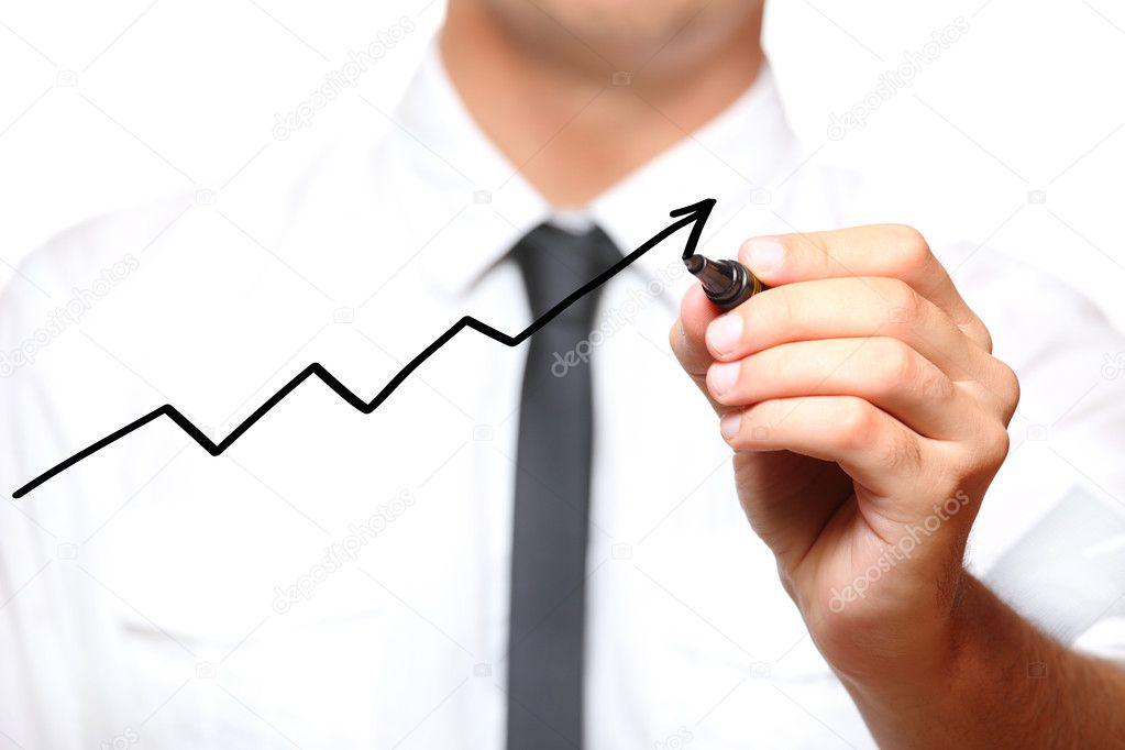 Businessman drawing an arrow going up