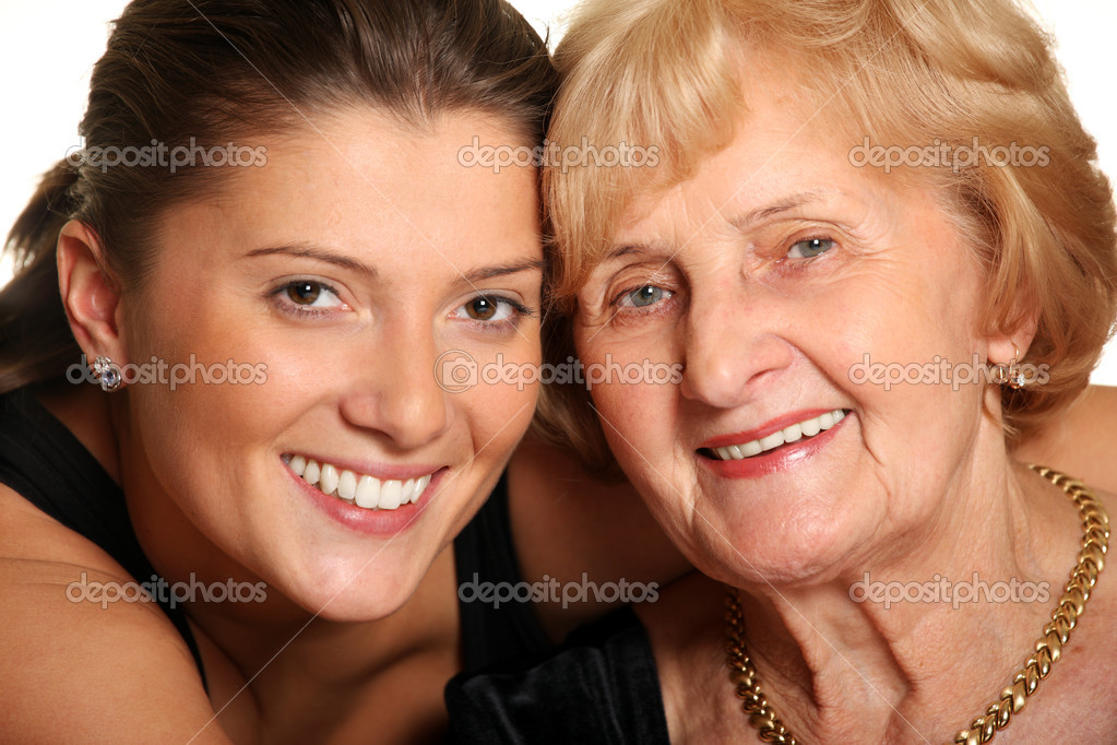 A portrait of a granddaughter hugging her grandma over white background