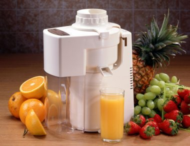 Juicer with glass and fruit